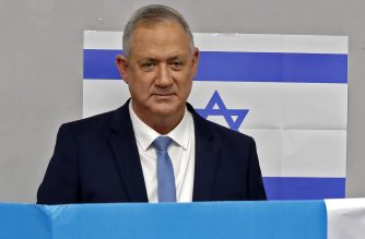 Israeli centrist Blue and White party and ex-military chief Benny Gantz votes at a polling station in the city of Rosh Hayin during parliamentary election on March 2, 2020. - Israelis were voting for a third time in 12 months today, with embattled Prime Minister Benjamin Netanyahu seeking to end the country's political crisis and save his career. (Photo by Jack GUEZ / AFP)