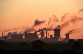(FILES) In this file photo taken on May 22, 2019, vapour is pictured rising from British Steel's Scunthorpe plant at dawn in north Lincolnshire, north east England - UK manufacturing activity rebounded in February to a ten-month high on easing Brexit uncertainty, but supply chains were nevertheless pressured by coronavirus concerns, data showed on March 2, 2020. The IHS Markit UK Manufacturing purchasing managers' index (PMI) stood at 51.7 last month, the group said in a statement. (Photo by Lindsey Parnaby / AFP)