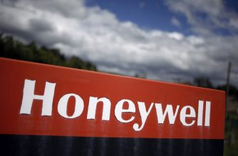"(FILES) In this file photo taken on June 21, 2012 a logo of US-based automotive supplier Honeywell International is pictured at the entrance of its factory, in Condé-sur-Noireau, northwestern France. - US manufacturing and technology group Honeywell said on March 3, 2020 it will bring to market ""the world's most powerful quantum computer"" aimed at tackling complex scientific and business challenges. The company said it had achieved a breakthrough in quantum computing, which uses subatomic particles to speed up processing, and would launch the new computers within three months. It released a scientific paper describing the accelerated quantum capability. (Photo by Charly TRIBALLEAU / AFP)"