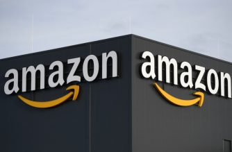 (FILES) This file picture shows the logo of US online retail giant Amazon at the distribution center in Moenchengladbach, western Germany, on December 17, 2019. - Amazon confirmed Tuesday that an employee who works in the internet giant's home city of Seattle had been quarantined after testing positive for the new coronavirus. (Photo by INA FASSBENDER / AFP)