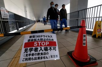 A bulletin board indicates that visitors cannot enter the Toyosu fish market to prevent the spread of the COVID-19 coronavirus at an entrance to the market on a bridge in Tokyo on March 5, 2020. - Japan plans to quarantine people coming from China and South Korea for two weeks to prevent the spread of the COVID-19 coronavirus, the Yomiuri daily reported on March 5. (Photo by Kazuhiro NOGI / AFP)