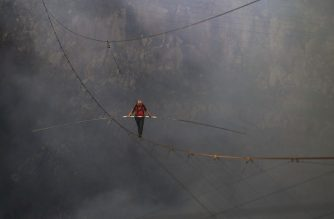 """Handout picture released on March 5, 2020 by American Broadcasting Companies (ABC) showing US acrobat Nik Wallenda as he crosses the 1,800 foot high wire walk over the Masaya Volcano in Nicaragua, on March 4, 2020. - Wallenda became the first person to complete the full crossing. (Photo by Oscar Duarte / American Broadcasting Companies / AFP) / TABLOIDS OUT; NO BOOK PUBLISHING WITHOUT PRIOR APPROVAL. NO ARCHIVE. NO RESALE. RESTRICTED TO EDITORIAL USE - MANDATORY CREDIT """"AFP PHOTO /ABC-OSCAR DUARTE"""" - NO MARKETING - NO ADVERTISING CAMPAIGNS - DISTRIBUTED AS A SERVICE TO CLIENTS"""