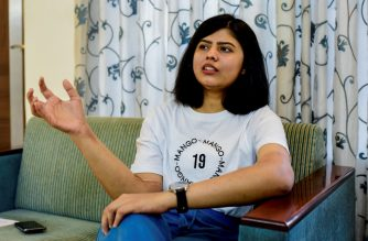 In this photo taken on March 7, 2020, Shreya Siddanagowder gestures as she talks during an interview with AFP at her home in Pune, more than two years after transplant surgery for both hands. - When amputee Shreya Siddanagowder was offered new hands, the Indian student didn't hesitate, even though they were big, hairy, once belonged to a man and were a different skin tone to her own. (Photo by Sanket Wankhade / AFP) / TO GO WITH India-health-amputee-science by Abhaya Srivastava