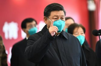"(File photo) This photo released on March 10, 2020 by China's Xinhua News Agency shows Chinese President Xi Jinping wearing a mask as he GESTURES to a coronavirus patient and medical staff via a video link at the Huoshenshan hospital in Wuhan, in China's central Hubei province on March 10, 2020. (Photo by Xie Huanchi / XINHUA / AFP) / China OUT - Hong Kong OUT - Japan OUT - Germany OUT - United States OUT - United Kingdom OUT / -----EDITORS NOTE---- RESTRICTED TO EDITORIAL USE - ONE TIME USE - MANDATORY CREDIT ""AFP PHOTO/XINHUA / XIE HUANCHI"" - NO MARKETING NO ADVERTISING CAMPAIGNS - DISTRIBUTED AS A SERVICE TO CLIENTS - NO ARCHIVES /"