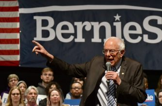 """(FILES) In this file photo taken on March 9, 2020 Democratic presidential hopeful Senator Bernie Sanders speaks at a """"Bernie 2020"""" rally at the Stifel Theater in downtown St.Louis, Missouri. - Sanders cancelled a campaign rally for first time over COVID-19, coronavirus, fears on March 10, 2020. (Photo by Tim VIZER / AFP)"""