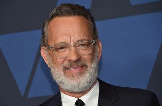 (FILES) In this file photo US actor Tom Hanks arrives to attend the 11th Annual Governors Awards gala hosted by the Academy of Motion Picture Arts and Sciences at the Dolby Theater in Hollywood on October 27, 2019. - Tom Hanks and his wife Rita Wilson have both tested positive for coronavirus, the US actor said Wednesday. Hanks, 63, said he and Wilson came down with a fever while in Australia, and will now be isolated and monitored. (Photo by Chris Delmas / AFP)