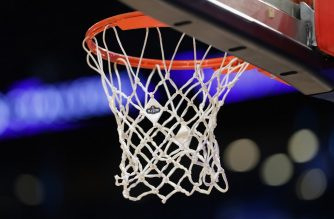 (FILES) In this file photo the 2017 NBA All-Star logo is seen on a net prior to the 2017 BBVA Compass Rising Stars Challenge at Smoothie King Center on February 17, 2017 in New Orleans, Louisiana. - NBA suspends the regular season after a case of coronavirus in a player (official) (Photo by RONALD MARTINEZ / GETTY IMAGES NORTH AMERICA / AFP)