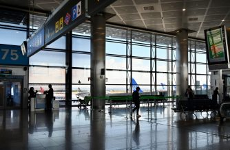 Picture shows the Madrid-Barajas Adolfo Suarez Airport in Barajas on March 14, 2020. - Madrid became a ghost town today with shops closed and streets and squares deserted as Spain recorded hundreds of new coronavirus infections. An eerie calm descended on the Spanish capital as well as Rome, Dublin and other European cities as people obeyed strict government measures designed to stem the spread of the disease and stayed home. (Photo by GABRIEL BOUYS / AFP)