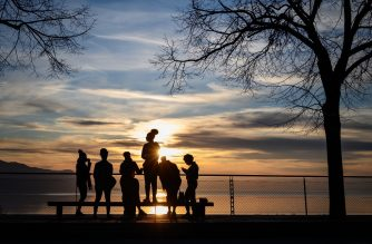 Youngster gather at sunset above Montreux on March 15, 2020. - Swiss officials urged people not to be afraid as cases of COVID-19 surged and drastic measures to halt the spread of the virus took hold. On March 13, 2020, the government closed schools and banned public gatherings of more than 100 people and the army said it was preparing to help overstretched hospitals. (Photo by Fabrice COFFRINI / AFP)