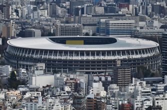 "(FILES) In this file photo taken on March 9, 2020 the New Tokyo Stadium, the main venue for the 2020 Olympic Games, is pictured from a viewing area in Tokyo. - Japan has asked for a one-year postponement of the Tokyo 2020 Games over the global coronavirus pandemic, and the International Olympic Committee has agreed, the country's prime minister said on March 24, 2020. ""I proposed to postpone for about a year and president Bach responded with 100 percent agreement,"" Shinzo Abe told reporters referring to Thomas Bach, head of the IOC. (Photo by CHARLY TRIBALLEAU / AFP)"