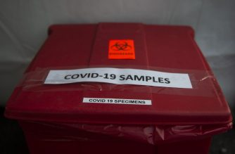 A bucket used to collect samples after people have been tested for coronavirus, COVID-19, is seen at a drive through testing site in Arlington, Virginia on March 20, 2020 (Photo by ANDREW CABALLERO-REYNOLDS / AFP)
