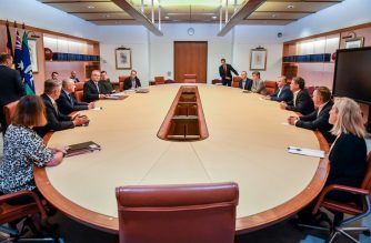 """Australian Prime Minister Scott Morrison (L) sits with cabinet ministers and the Leader of the Opposition Labor Party Anthony Albanese (R) at Parliament House in Canberra on March 22, 2020. (Photo by MICK TSIKAS / POOL / AFP) / """"The erroneous mention[s] appearing in the metadata of this photo by DAVID GRAY has been modified in AFP systems in the following manner: [POOL / Mick Tsikas] instead of [DAVID GRAY]. Please immediately remove the erroneous mention[s] from all your online services and delete it (them) from your servers. If you have been authorized by AFP to distribute it (them) to third parties, please ensure that the same actions are carried out by them. Failure to promptly comply with these instructions will entail liability on your part for any continued or post notification usage. Therefore we thank you very much for all your attention and prompt action. We are sorry for the inconvenience this notification may cause and remain at your disposal for any further information you may require."""""""