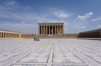 People walk at empty square around Anitkabir, the mausoleum of the founder of the Turkish Republic Mustafa Kemal Ataturk, in Ankara on March 23, 2020, as part of measures taken to prevent the spread of the Covid-19 disease caused by the novel coronavirus. - Turkey has announced a raft of measures to limit the spread of the virus, including the closure of schools and universities, and shutting mosques to mass gatherings. (Photo by Adem ALTAN / AFP)