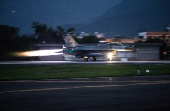 """This handout picture taken and released by Taiwan's Military News Agency (MNA) on March 24, 2020 shows a US-made F-16 fighter taking off during a drill at the Hualien Air Force Base in eastern Taiwan. - Military tensions have risen between Taiwan and China despite the global coronavirus pandemic after Beijing conducted a series of military drills near the island. (Photo by Handout / Taiwan's Military News Agency (MNA) / AFP) / RESTRICTED TO EDITORIAL USE - MANDATORY CREDIT """"AFP PHOTO /Taiwan's Military News Agency (MNA) """" - NO MARKETING - NO ADVERTISING CAMPAIGNS - DISTRIBUTED AS A SERVICE TO CLIENTS"""
