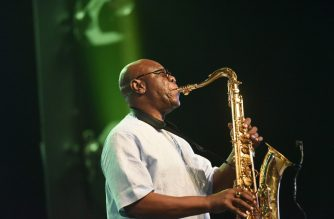 (FILES) In this file photo taken on June 30, 2018 (FILES) In this file photo taken on June 30, 2018, Emmanuel N'Djoke Dibango, known as Manu Dibango, saxophonist and Franco-Cameroonian singer of world jazz, performs during his concert   at the Ivory Hotel Abidjan. - Veteran Afro jazz star Manu Dibango died of the COVID-19 (the novel coronavirus) said relatives on March 24, 2020. (Photo by Sia KAMBOU / AFP)