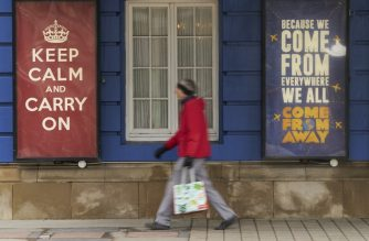 A woman walks past the Royal Alexandra Theatre in Toronto, Ontario on March 24, 2020. - The province of Ontario has set a deadline of midnight Tuesday for all non-essential businesses to close due to the Covid-19 outbreak. Prime Minister Justin Trudeau's online plea for people to stay home during the coronavirus pandemic has gone viral, with actor Ryan Reynolds, musician Michael Buble and other Canadian celebrities on Tuesday helping to spread the word. (Photo by Geoff Robins / AFP)