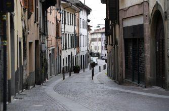A general view shows a deserted street in Albino near Bergamo, Lombardy, on March 25, 2020, during the country's lockdown following the COVID-19 new coronavirus pandemic. (Photo by MIGUEL MEDINA / AFP)
