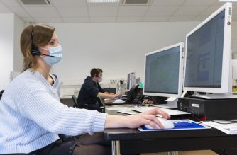"""Medical staff work in a newly-built """"Saxony's central Corona center"""" at the University Hospital to dispatch  patients during the novel coronavirus pandemic on March 26, 2020 in Dresden, eastern Germany. (Photo by MATTHIAS RIETSCHEL / various sources / AFP)"""