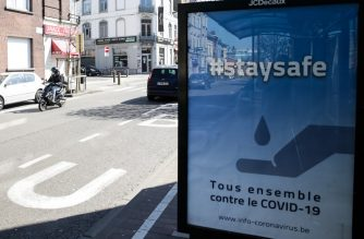National sign campaign urging people to be safe and stay home is placed near the European Parliament  in Brussels on March 26, 2020, as the nation tries to stem the spread of the COVID-19, the disease caused by the novel coronavirus. - Due to Coronavirus pandemic, Belgium is implementing confinement guidelines for the public which is scheduled to be in place until April 5, 2020. Only supermarkets and essential trade will remain open. Countries around the world are taking increased measures to stem the further spread of the SARS-CoV-2 coronavirus which causes the Covid-19 disease. (Photo by Aris Oikonomou / AFP)