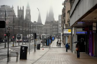 A quiet Princes Street is seen in Edinburgh, Scotland on March 26, 2020 after the government ordered a lockdown to help stop the spread of the novel coronavirus COVID-19. - The coronavirus outbreak and resulting lockdown of billions of people threatens the global economy to the point where economists are predicting the most violent recession in recent history, perhaps even eclipsing the Great Depression. (Photo by ANDY BUCHANAN / AFP)