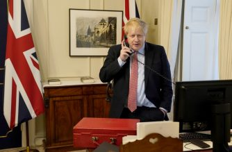"""A handout picture released by 10 Downing Street, the office of the British prime minister, on March 25, 2020 shows Britain's Prime Minister Boris Johnson on the telephone in his office in 10 Downing Street, to Queen Elizabeth II for their weekly Audience during the coronavirus crisis. - Britain's Prime Minister Boris Johnson has tested positive for the new coronavirus COVID-19 and is self-isolating in 10 Downing Street, it was announced on March 27, 2020. Johnson experienced """"mild symptoms"""" on March 26 and was tested at Number 10 by NHS staff, a statement said. (Photo by Andrew PARSONS / 10 Downing Street / AFP) / RESTRICTED TO EDITORIAL USE - MANDATORY CREDIT """"AFP PHOTO / 10 DOWNING STREET / ANDREW PARSONS"""" - NO MARKETING - NO ADVERTISING CAMPAIGNS - DISTRIBUTED AS A SERVICE TO CLIENTS"""