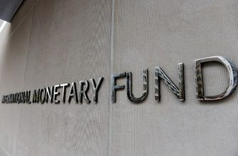An exterior view of the building of the International Monetary Fund (IMF) is seen on March 27, 2020 in Washington, DC. - The coronavirus pandemic has driven the global economy into a downturn that will require massive funding to help developing nations, IMF chief Kristalina Georgieva said on March 27, 2020. (Photo by Olivier DOULIERY / AFP)