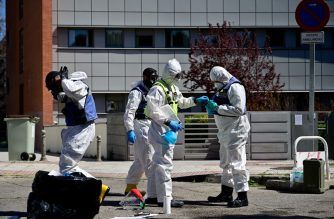 Members of the Military Emergencies Unit (UME) prepare to carry out a general disinfection at the Arturo Soria residence for the elderly in Madrid on March 28, 2020 amid a national lockdown to fight the spread of the COVID-19 coronavirus. - The death toll from coronavirus in Spain surged over 5,600 after a record 832 people died in 24 hours, and the number of infections soared over 72,000, the government said. Spain has the world's second-highest coronavirus death toll after Italy with 5,690 fatalities. (Photo by Pierre-Philippe Marcou / AFP)