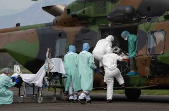 "This handout picture released and taken on March 29, 2020 by the French Ministry of the Armed Forces (Ministere des Armees) shows medical staff unloading two Covid-19 affected patients upon their arrival onboard a NH90 Caiman helicopter of the 1st RHC at Grenoble Le Versoud airport, after being evacuated from a hospital in Besancon, northeastern France, to the universitary hospital (CHU) of Grenoble, eastern France, as part of the Operation Resilience amid the outbreak of the COVID-19 caused by the novel coronavirus. (Photo by Handout / MINISTERE DES ARMEES / AFP) / RESTRICTED TO EDITORIAL USE - MANDATORY CREDIT ""AFP PHOTO/ MINISTERE DES ARMEES/ HANDOUT"" - NO MARKETING - NO ADVERTISING CAMPAIGNS - DISTRIBUTED AS A SERVICE TO CLIENTS"
