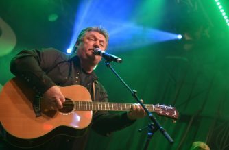 "(FILES) In this file photo taken on November 11, 2014 Musician Joe Diffie performs during Tootsie's Orchid Lounge 54th Birthday Bash at Tootsie's Orchid Lounge in Nashville, Tennessee. - Joe Diffie, a Grammy award-winning country music singer who had several chart-topping hits in the 1990s, has died of coronavirus. He was 61. Diffie's death was announced on his Facebook page, which said he died on March 29, 2020 ""from complications of coronavirus."" (Photo by Jason Davis / GETTY IMAGES NORTH AMERICA / AFP)"