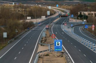 "Picture shows the almost empty A1 highway in Burgos on March 30, 2020, on the day that all non-essential activities were ordered to halt trying to contain the coronavirus spread. - Spain, already struggling with high unemployment and debt, is bracing for the impact of the government's decision to put the country's economy into ""hibernation"" to fight the spread of coronavirus. Grappling with Europe's second-worst outbreak of the disease after Italy, the government on March 14 imposed a lockdown and yesterday it went even further, banning all non-essential work for two weeks in the nation of around 47 million people. (Photo by CESAR MANSO / AFP)"