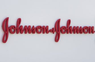 (FILES) In this file photo taken on August 28, 2019 an entry sign to the Johnson & Johnson campus shows their logo in Irvine, California. - Johnson & Johnson said on March 30, 2020 it had selected a lead candidate vaccine for the new coronavirus that would move to human trials by September and could be ready for emergency use by early next year. (Photo by Mark RALSTON / AFP)