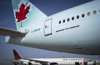 (FILES) In this file photo taken on August 6, 2018 Air Canada planes sit on the tarmac of Roissy-Charles de Gaulle Airport, north of Paris. - Air Canada announced on March 30, 2020 that it would temporarily lay off nearly half of its employees and reduce activity by up to 90 percent in the second quarter due to the coronavirus. (Photo by JOEL SAGET / AFP)