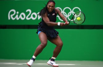 (FILES) This file photo taken on August 7, 2016 shows Serena Williams of the US hitting a return against Australia's Daria Gavrilova during their women's first round singles tennis match at the Olympic Tennis Centre at the Rio 2016 Olympic Games in Rio de Janeiro. - Fear, stress and money worries: COVID-19 coronavirus lockdown can be challenging for anyone, but spare a thought for the athletes whose livelihoods could be at stake, with a corresponding toll on their mental health. (Photo by Roberto SCHMIDT / AFP) / TO GO WITH  Health-virus-sports-psychology,FOCUS
