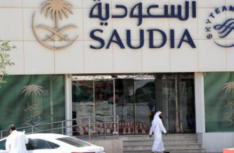 A picture taken on June 6, 2017 shows a Saudi man walking past the Saudi Airlines headquarters in the capital Riyadh, after it had suspended all flights to Qatar following a severing of relations between major gulf states and the gas-rich country. - arab nations including Saudi Arabia and Egypt cut ties with Qatar accusing it of supporting extremism, in the biggest diplomatic crisis to hit the region in years. (Photo by FAYEZ NURELDINE / AFP)