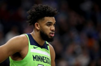 MINNEAPOLIS, MN - FEBRUARY 8: Karl-Anthony Towns #32 of the Minnesota Timberwolves looks on during a game against the LA Clippers on February 8, 2020 at Target Center in Minneapolis, Minnesota. NOTE TO USER: User expressly acknowledges and agrees that, by downloading and or using this Photograph, user is consenting to the terms and conditions of the Getty Images License Agreement. Mandatory Copyright Notice: Copyright 2020 NBAE   Jordan Johnson/NBAE via Getty Images/AFP