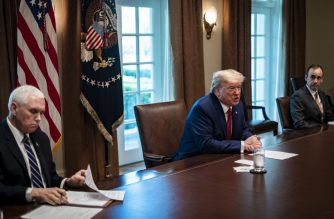 WASHINGTON, DC - MARCH 29: President Donald Trump meets with supply chain distributors in reference to the COVID-19 coronavirus pandemic, in the Cabinet Room in the West Wing at the White House on Sunday, March 29, 2020.   Pete Marovich-Pool/Getty Images/AFP