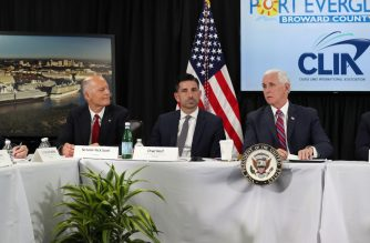 FORT LAUDERDALE, FLORIDA - MARCH 07: Sen. Rick Scott, Chad F. Wolf, the acting Secretary of Homeland Security and Vice President Mike Pence participate in a discussion held at Port Everglades about possible coronavirus issues that the cruise line company leaders are experiencing on Saturday on March 07, 2020 in Fort Lauderdale, Florida. Vice President Pence and the coronavirus task force are heading up the efforts to combat the virus in the United States.   Joe Raedle/Getty Images/AFP
