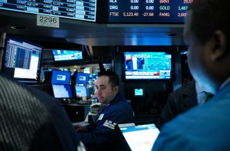 FILES: NEW YORK, NEW YORK - MARCH 17: Traders work on the floor of the New York Stock Exchange (NYSE) on March 17, 2020 in New York City. The Dow was up slightly in morning trading following a day that saw one of the worst drops in the market's history as America and the world react to the spreading of the coronavirus.   Spencer Platt/Getty Images/AFP