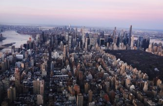 NEW YORK, NEW YORK - MARCH 18: Dawn breaks over Manhattan as the city struggles to contain the number of coronavirus cases on March 18, 2020 in New York City. Across the city businesses, schools and places of work have been shutting down leading to empty streets and quiet neighborhoods. New York City mayor Bill de Blasio has threatened to call for a 'shelter-in-place' order as Manhattan continues to see a rise in cases of the virus. World wide, 200,000 people have now contracted COVID-19.   Spencer Platt/Getty Images/AFP