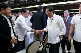 President Rodrigo Roa Duterte greets Labor and Employment Secretary Silvestre Bello III before the start of the meeting with the Inter-Agency Task Force for the Management of Emerging Infectious Diseases at the Malacañan Palace on March 9, 2020.