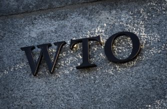"A sign of the World Trade Organization (WTO) is seen at the trade intergovernmental organization headquarters in Geneva on December 10, 2019. - WTO announced the launch of ""intensive"" political negotiations to salvage the appellate branch of the body's internal court, which is set to collapse under US opposition. (Photo by Fabrice COFFRINI / AFP)"