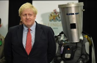 Britain's Prime Minister and Conservative leader Boris Johnson (L) waits with other candidates as the results are read out for the race to be MP for Uxbridge and Ruislip South at the count centre in Uxbridge, west London, on December 13, 2019 after votes were counted as part of the UK general election. - Prime Minister Boris Johnson's ruling party appeared on course for a sweeping victory in Thursday's snap election, an exit poll showed, paving the way for Britain to leave the EU next month after years of political deadlock. (Photo by Oli SCARFF / AFP)