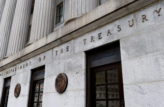 An exterior view of the building of US Department of the Treasury is seen on March 27, 2020 in Washington, DC. - US Treasury Secretary Steven Mnuchin on Friday pledged to quickly send cash to Americans as part of the a massive $2.2 trillion relief package aimed at rescuing the coronavirus-battered economy. (Photo by Olivier DOULIERY / AFP)
