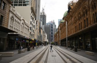 Near-deserted streets are seen in the central business district as people stay home due to the COVID-19 novel coronavirus outbreak in Sydney on March 30, 2020. - Australia has recorded almost 4,000 cases of the coronavirus, COVID-19, with the death toll rising to 17 as of March 30. (Photo by PETER PARKS / AFP)