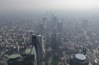 Aerial view showing low visibility due to air pollution in Mexico City, on March 30, 2020 during the new coronavirus, COVID-19, pandemic. - The Mexican government on March 30 declared health emergency for the coronavirus pandemic until April 30 as the number of COVID-19 cases increases in the country. (Photo by Pedro PARDO / AFP)