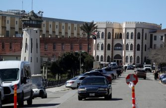 (FILES) This file photo taken on March 13, 2019 shows a view of San Quentin State Prison on March 13, 2019 in San Quentin, California. - The prison system in the largest US state of California plans to release about 3,500 non-violent inmates early to help mitigate the spread of the COVID-19 illness, officials said on March 31, 2020. (Photo by JUSTIN SULLIVAN / GETTY IMAGES NORTH AMERICA / AFP)