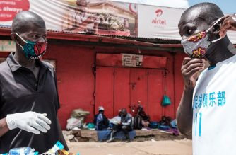 A mask vendor sells home-made masks at Nakasero market in Kampala on April 1, 2020. - Ugandan President Yoweri Museveni on March 30, 2020, ordered an immediate 14-day nationwide lockdown in a bid to halt the spread of the COVID-19 coronavirus which has so far infected 33 people in the country. (Photo by SUMY SADURNI / AFP)