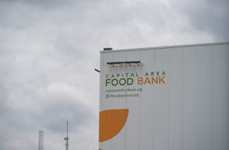 "The Capital Area Food Bank on April 1, 2020 in Washington, DC. - The coronavirus pandemic is putting a strain on US food banks, which are short on volunteers and donations while food requests increase. ""Some people are hungrier than ever before and others need to act, help and not be afraid,"" says Rob Britton, a volunteer at the Washington Area Food Bank (CAFB). (Photo by Alex Edelman / AFP)"