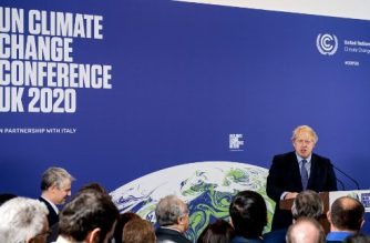 "(FILES) In this file photo taken on February 04, 2020 Britain's Prime Minister Boris Johnson speaks during an event to launch the United Nations' Climate Change conference, COP26, in central London. - The UN's COP 26 climate change summit due to take place in the Scottish city of Glasgow in November has been postponed due to the coronavirus pandemic, the British government said on Wednesday. ""In light of the ongoing, worldwide effects of COVID-19, holding an ambitious, inclusive COP26 in November 2020 is no longer possible,"" the government said in a statement, adding that dates for a rescheduled conference in 2021 would be announced later. (Photo by Chris J Ratcliffe / POOL / AFP)"
