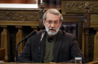 """(FILES) In this file photo taken on December 1, 2019 Iran's Parliament speaker Ali Larijani speaks during a press conference in the capital Tehran. - Iran's parliament speaker tested positive for COVID-19, state TV reported on April 2, 2020, becoming the latest official to contract the disease in the country, which has been hard hit by the novel coronavirus. Ali Larijani """"was tested for coronavirus after showing certain symptoms, and as the result was positive, he is currently in quarantine and undergoing treatment,"""" the report said. (Photo by STR / AFP)"""